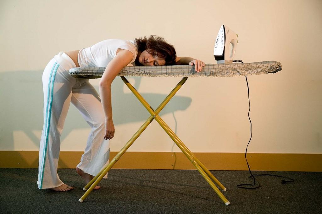 Woman laying on ironing board