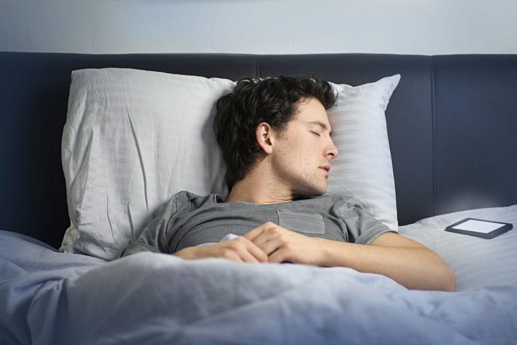 man asleep in bed with mobile phone