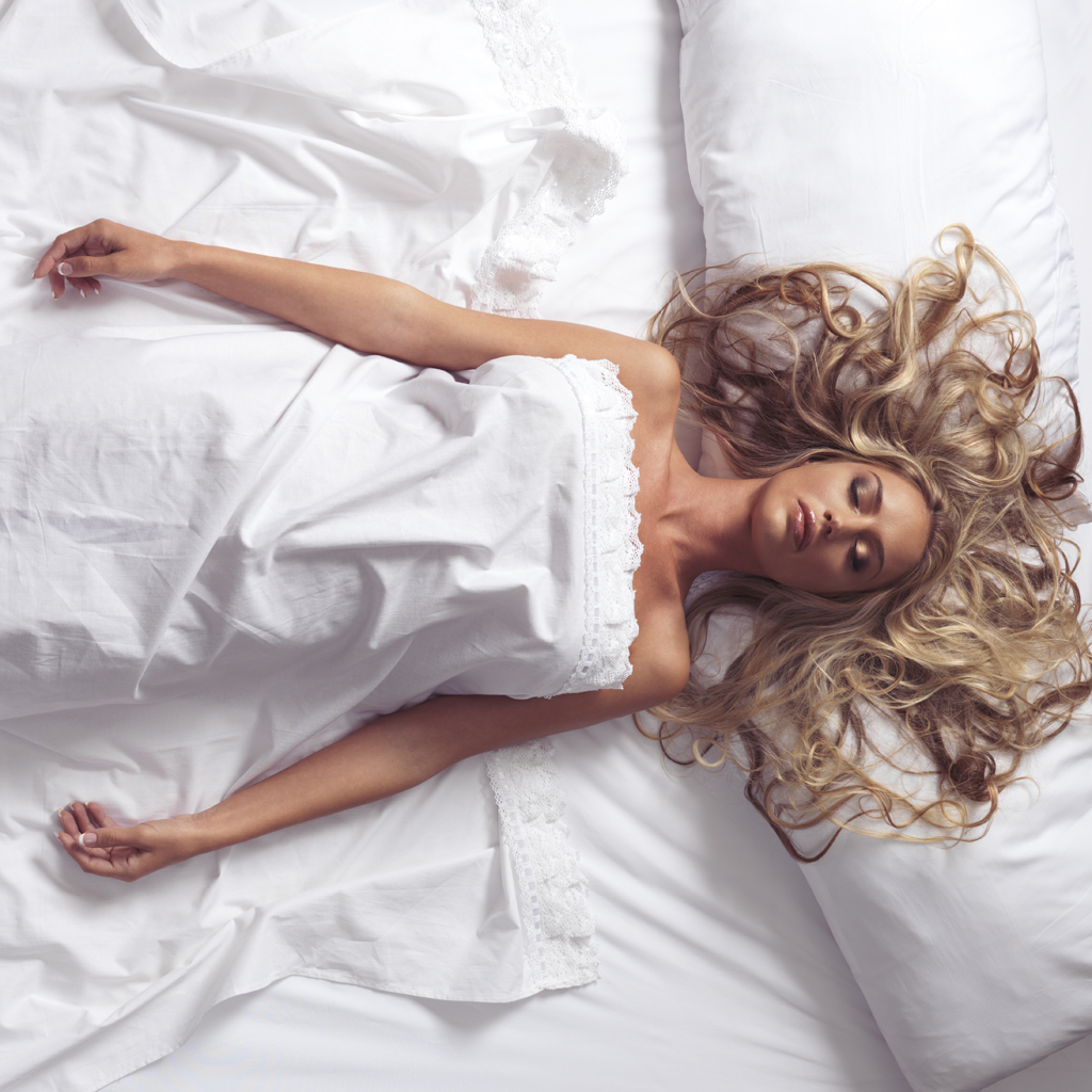 Mandatory Credit: Photo by Image Broker/REX (3717024a) MODEL RELEASED Sleeping young woman with long blond hair lying in bed with white sheets VARIOUS