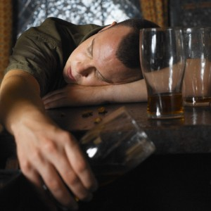 Drunk Man with Head Resting on Bar --- Image by © David Vintiner/zefa/Corbis