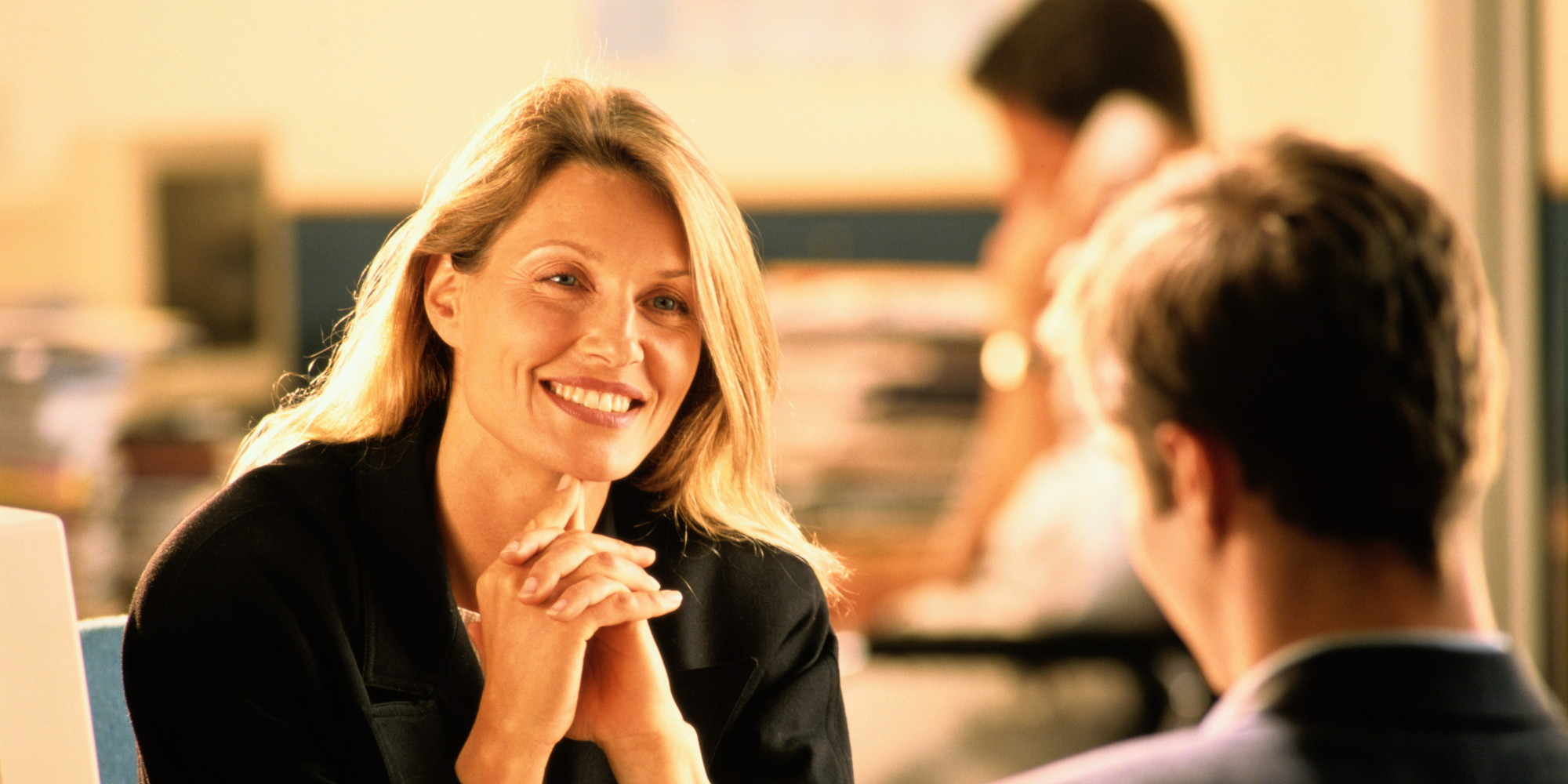 Businesswoman in discussion with male colleague